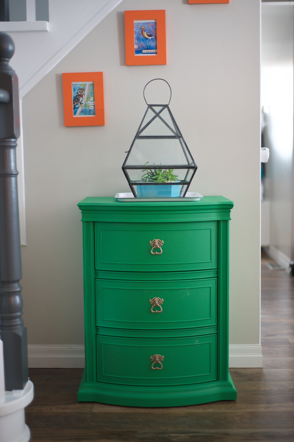 Beautiful (and a little playful) emerald green and the light gold hardware that makes those pulls just pop!