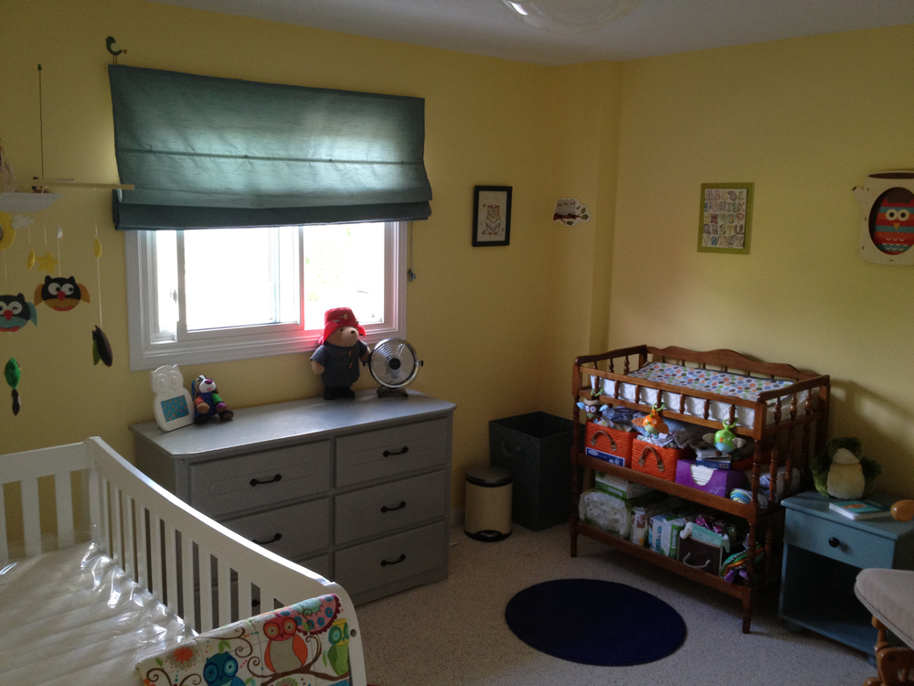 Butter yellow walls, painted dresser & the change table that my mom used for me when I was a baby!