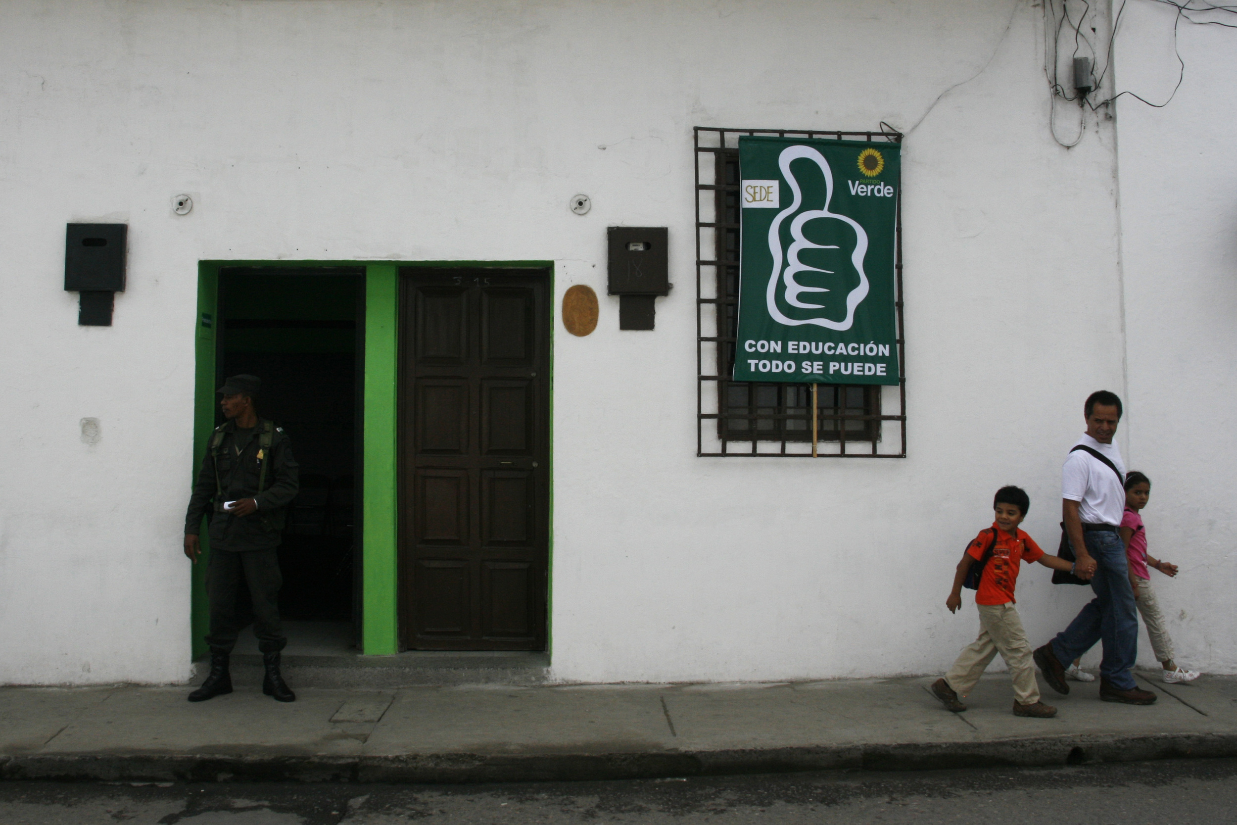 A guard stands outside the campaign office of the Green Party in  Popayan, Colombia.