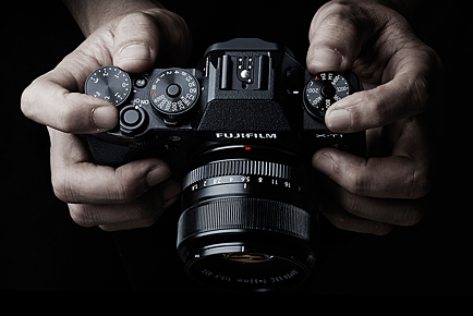 Not a shot of my hands holding an X-T1, but it does illustrate the top-panel layout, and where all the controls fall. Of course, there are buttons and switches on the back and front of the body as well.