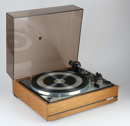 Dual 1219 Automatic Record Changer and United Audio turntable cabinet.