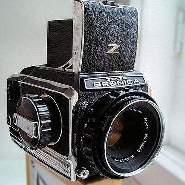 Bronica S2A with Nikkor 75mm f/2.8 lens, waste-level finder, and back.  image: camera-wiki.org