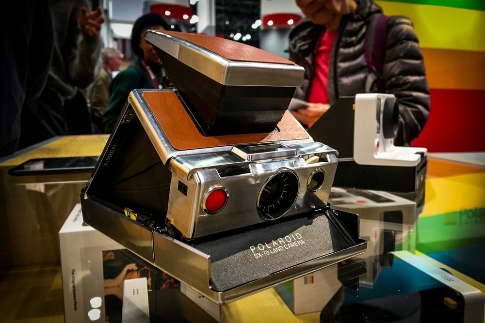 "If you ask me, nothing says ""cool"" like a Polaroid SX-70"