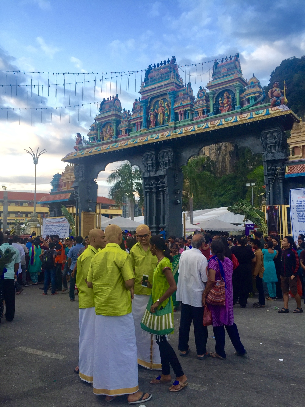 Approaching the entrance to Batu Caves in Gombok, Malaysia - a group of newly shaven men.