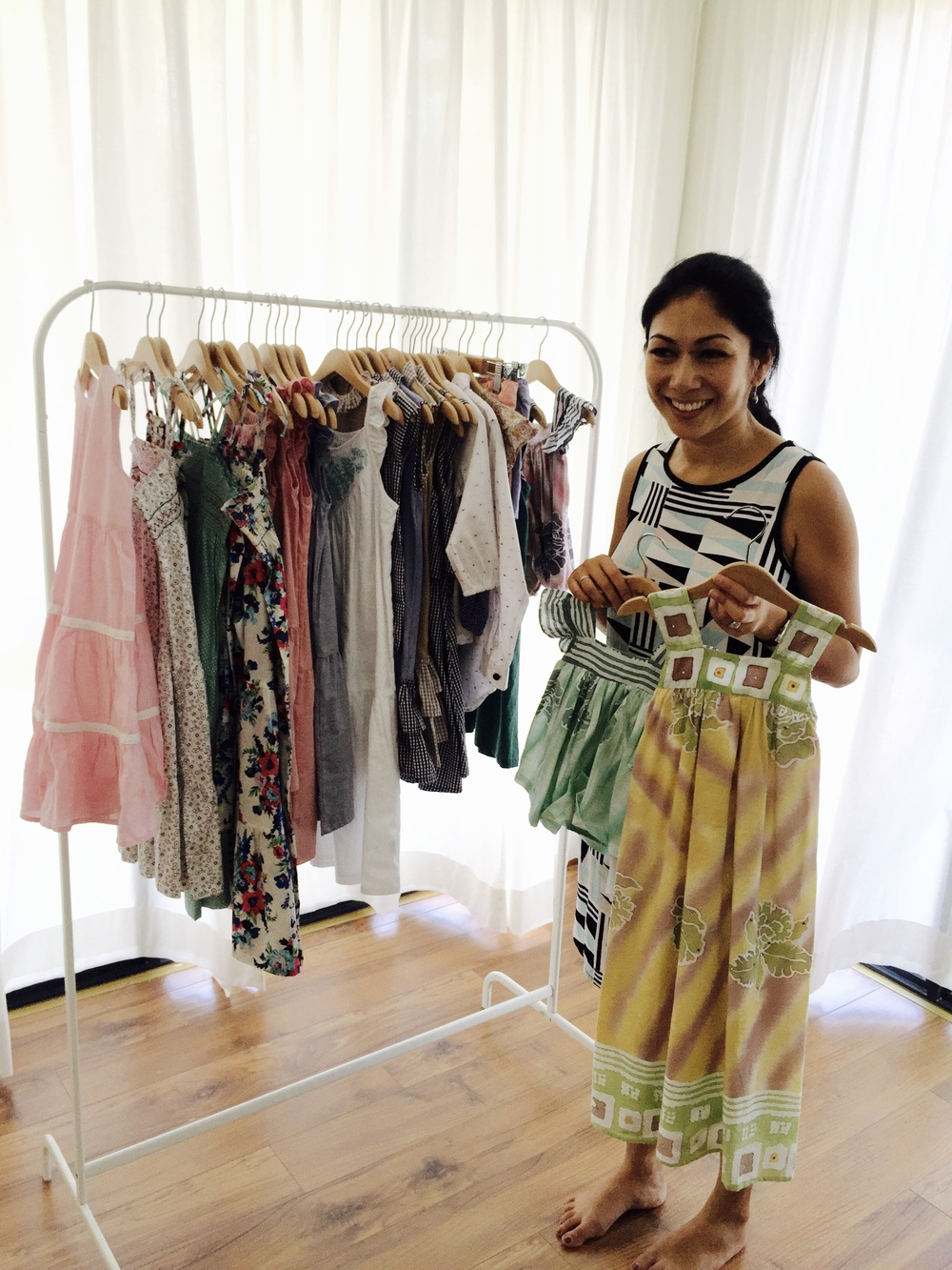 Natasha at her studio with a rack of her designs