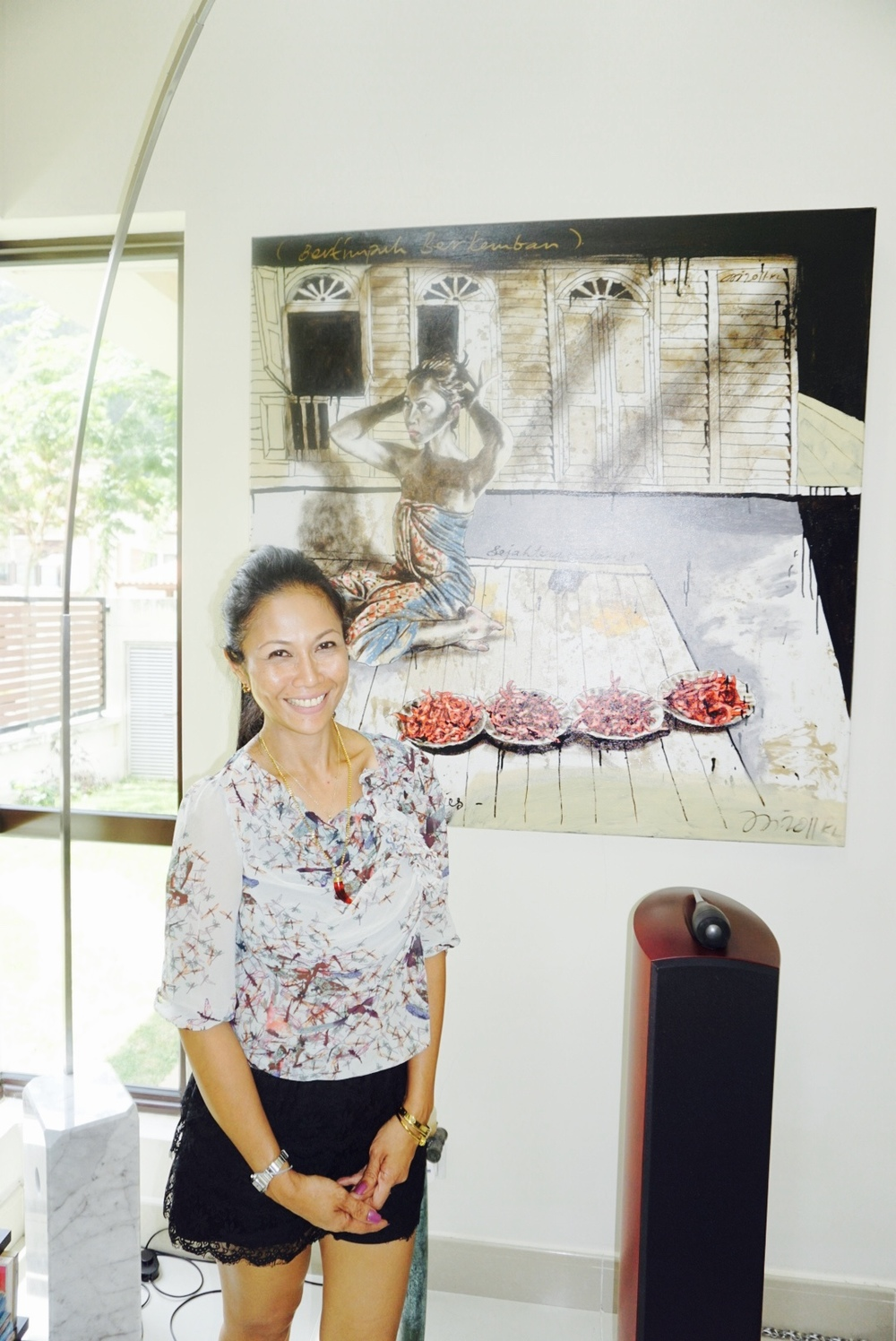 Adilah posing in front of her portrait completed in 2011 way before the launch of Dapur Sainer.