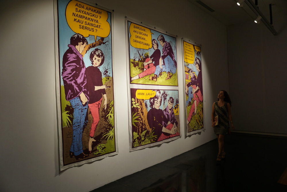 Admiring the Indonesian comic/pop art style of batik painting by Indonesian artistBambang 'Toko' Witjaksono, 2015.  The wording is an interesting juxtaposition against the old school comic style.