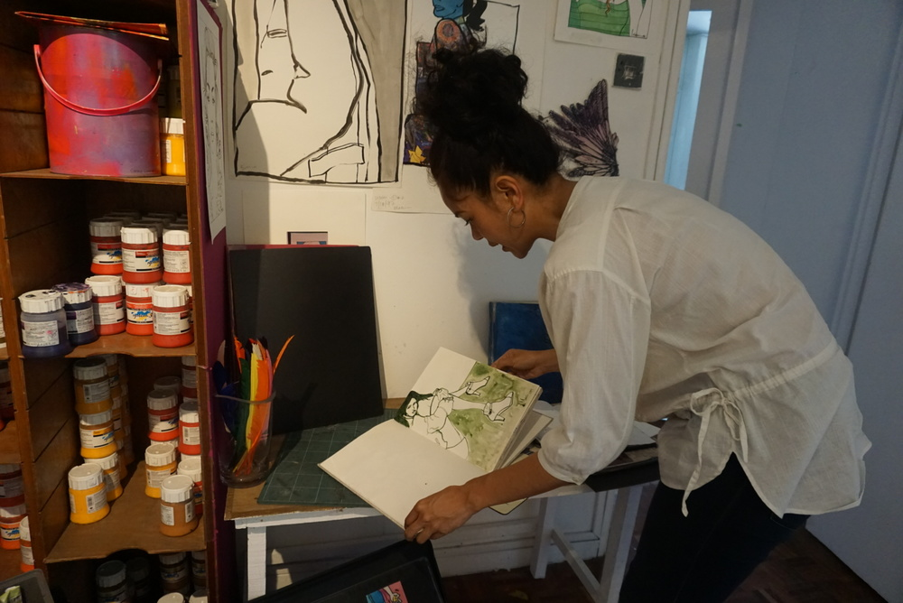 Nini in her studio showing me her sketches and drawings collected throughout the years,