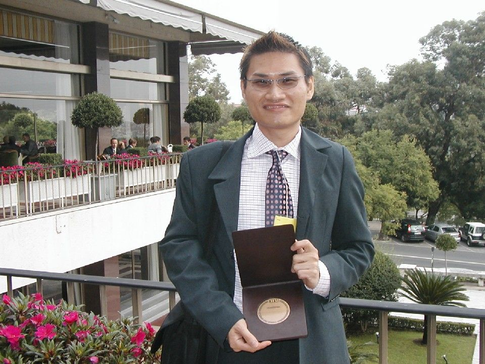 Josh and his Best Student Award for Postgraduate Category by IFEAT (International Federation of Essential Oils and Aroma Trade) in 2004.   Picture courtesy of Josh Lee.