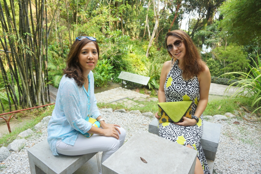 Sitting pretty at the Tropical Spice Garden dressed in Coffee&Covet's light blue Aryani shirt and a Frankitas Sabeena clutch.  Yiga wears the Coffee&Covet's Tati maxi halter dress and Frankitas' Maren bag (more details at the end of the article!)