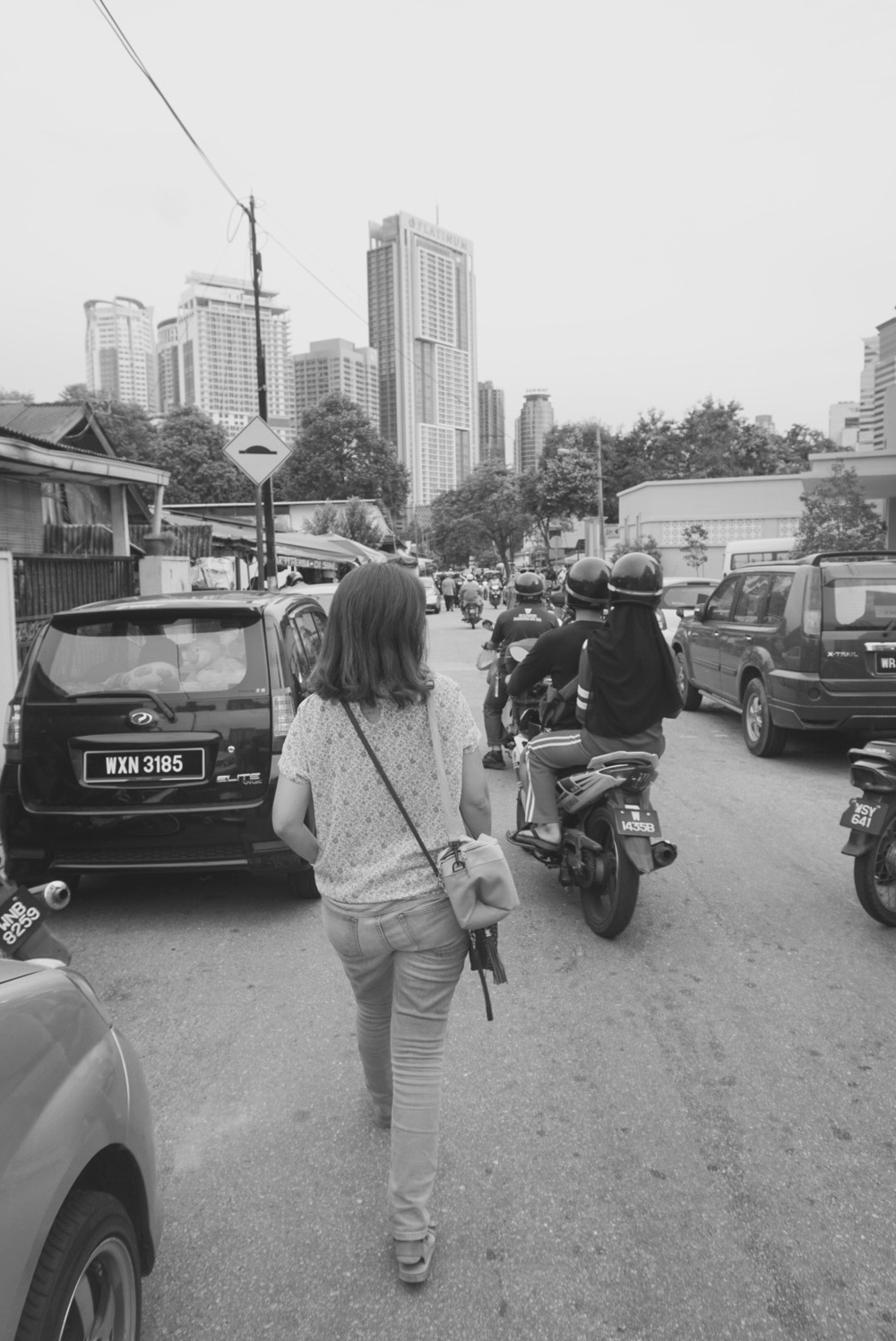 Weaving my way down the streets of Kampung Baru - in the company of many a motorbike!