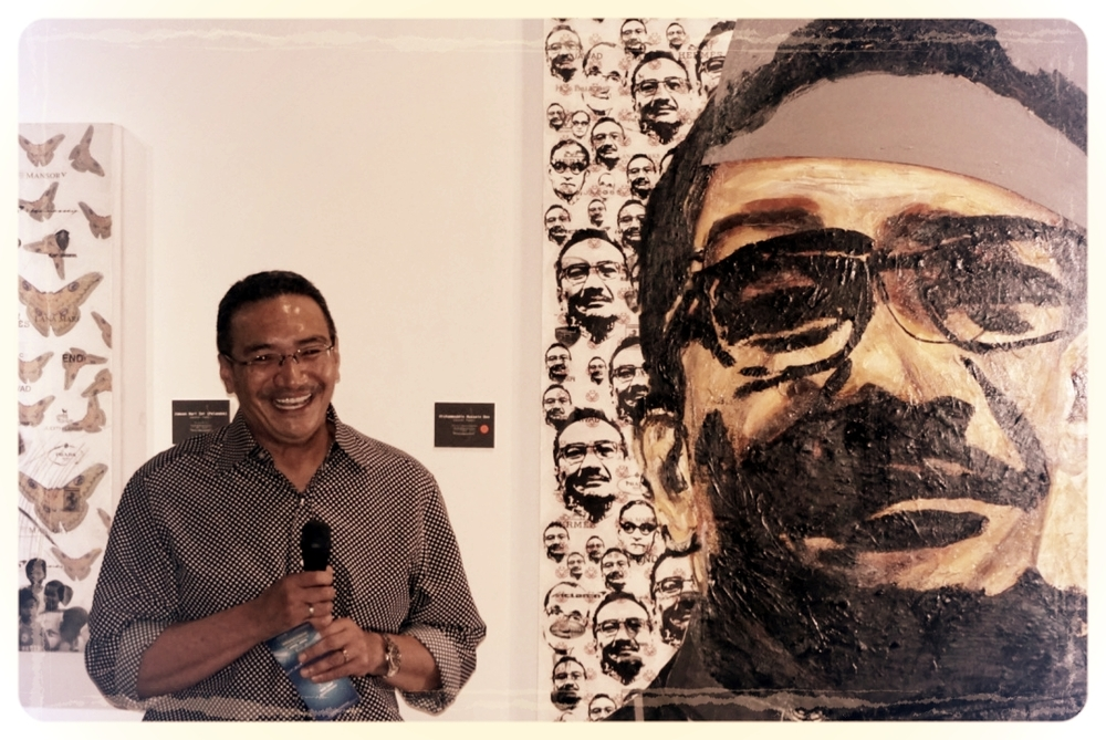 Datuk Seri Hishammuddin Hussein at Bebas launch - in front of his own portrait as part of the Onn series.