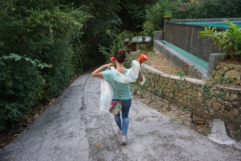 Slipping a dainty silk  Fern - The New Batik  scarf and a vibrant Frankitas  Tiyya  bag as we walked from our rustic part of the jungle hillside to the main resort area.
