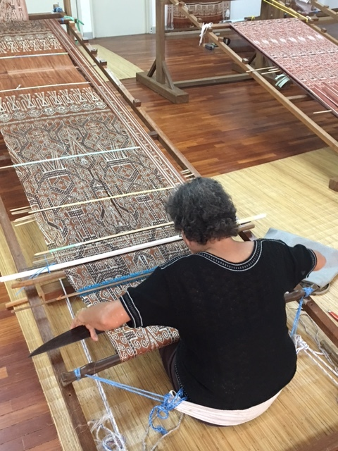 A local weaver working on a intricate Pua Kumbu piece at the Tun Jugah Foundation.