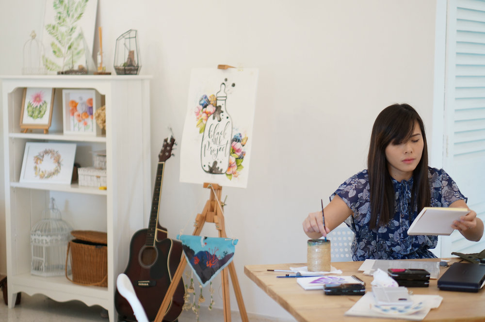 Wei Tieng at work on her watercolor illustrations at the new BMP studio in Subang Jaya