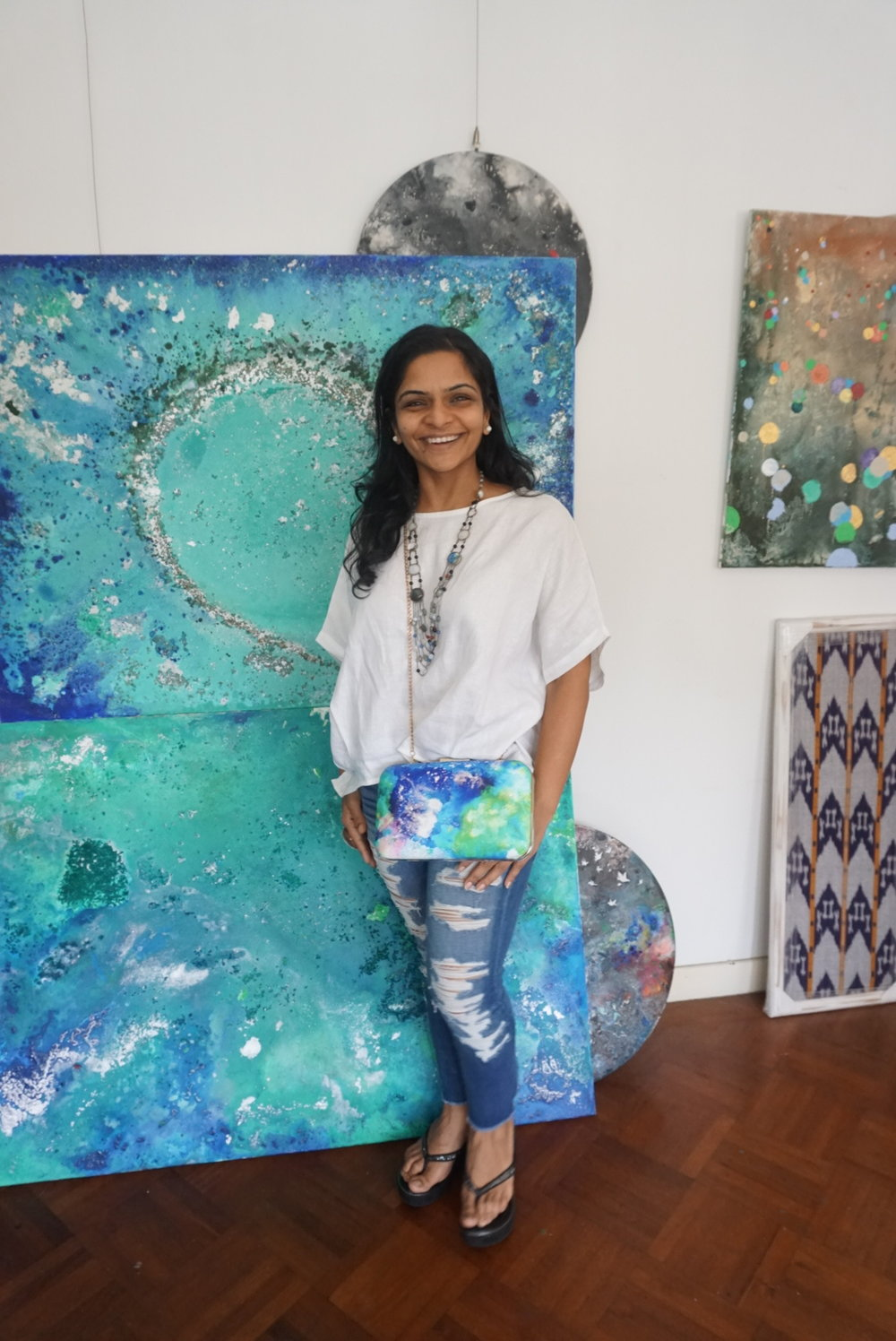 Shailly with her art and her handbag - we love these colours inspired by the ocean!