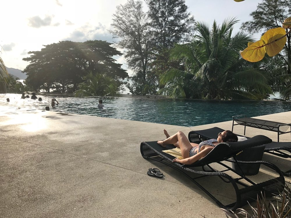 "My bestie enjoying the sun poolside at ""By The Sea"" in Batu Ferrenghi."