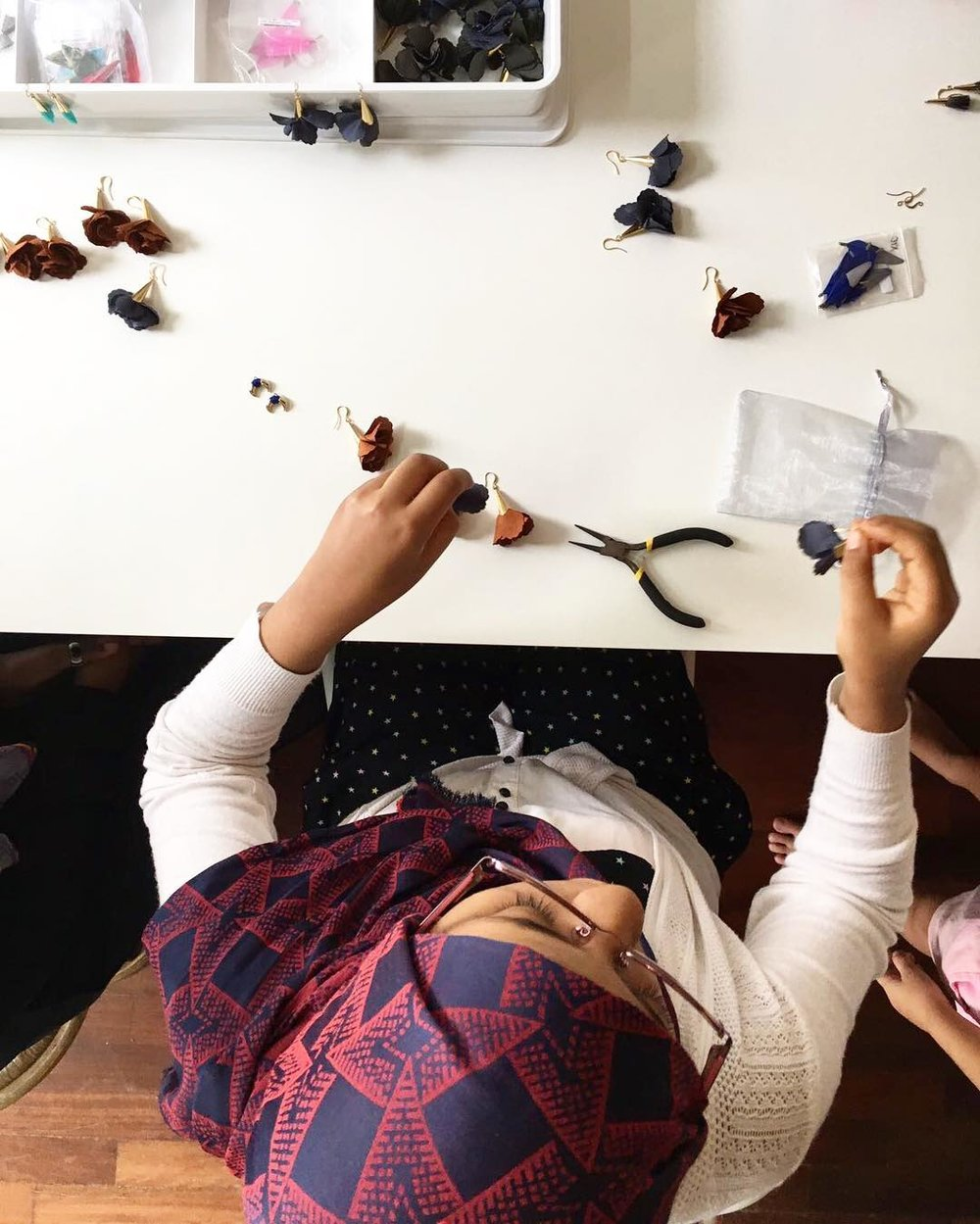 A Fugee school student in the middle of creating gorgeous  Fugeelah earrings! I have a pair too!