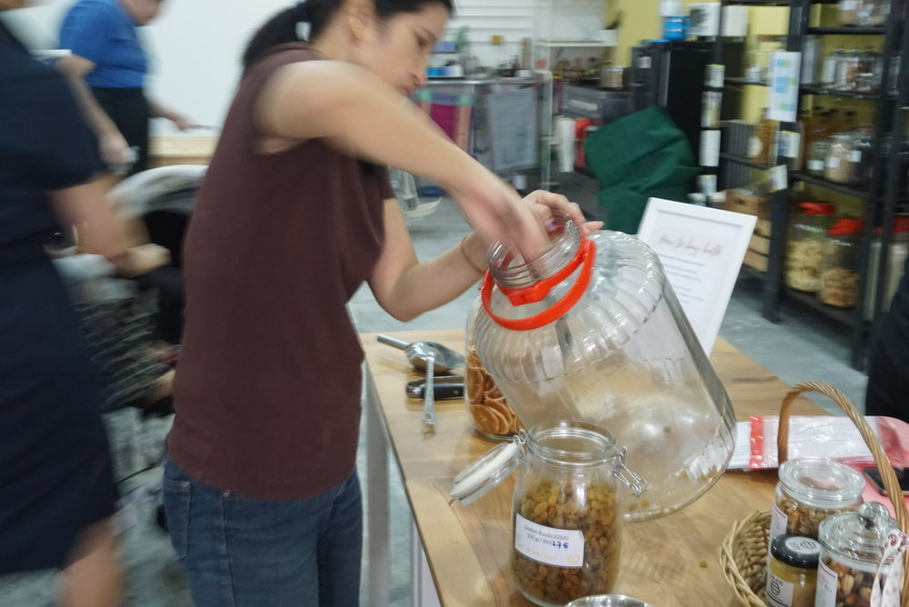 One of the Hive team members replenishing stocks from the dried food area