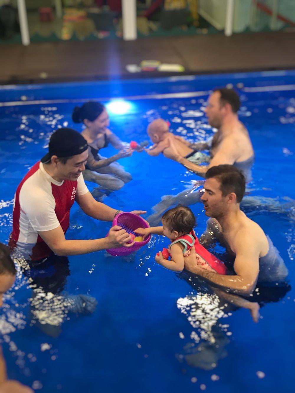 There's songs, there's games and under it all are steps towards getting these babies to swim independently!