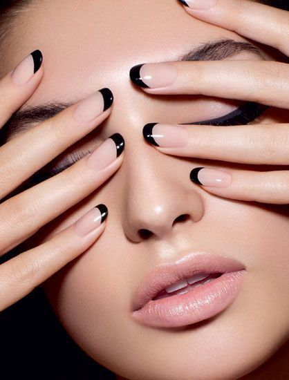 female model with black french tips holding her eyes