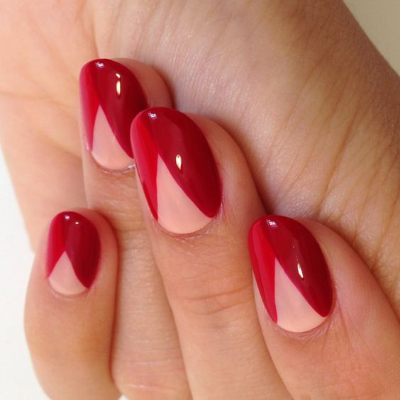 hand with red geometrical nail art