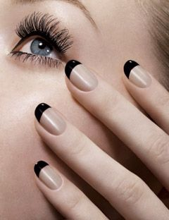 hand with black french tips holding face