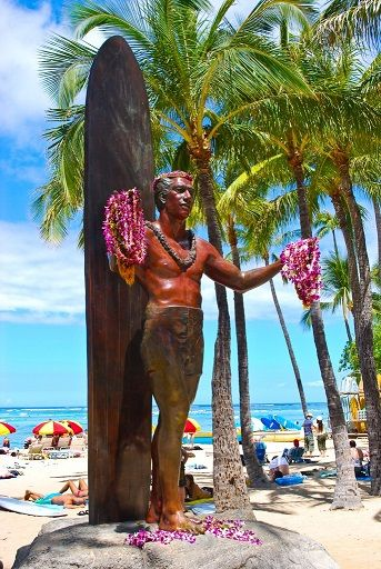 The statue of Duke Kahanamoku watches over Waikiki Beach