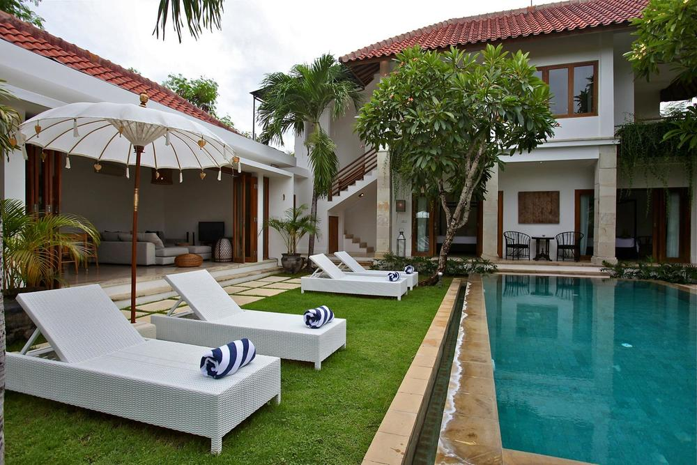 Resort in Bali with sun loungers and pool