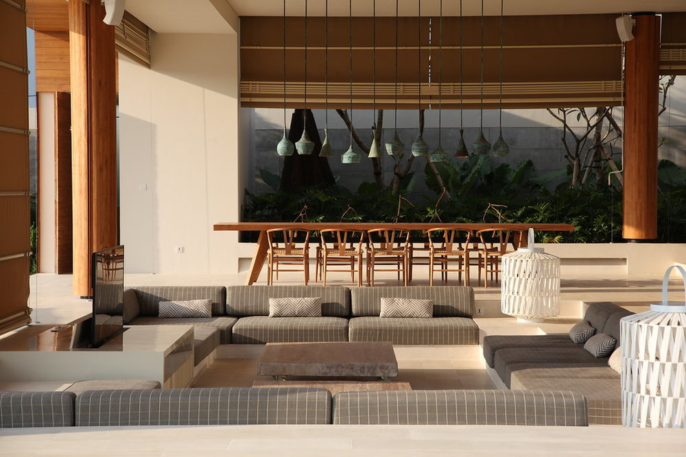 Outdoor area in Bali villa with wooden table and chairs