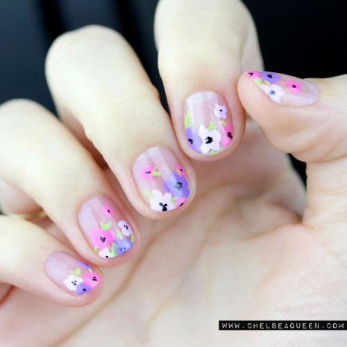 hand with pink floral nails