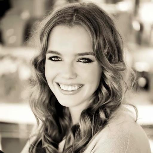 Blonde girl smiling in sepia filter