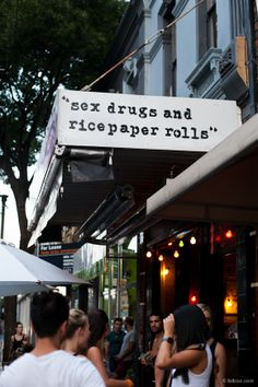 """""""sex drugs and rice paper rolls"""" sign above a restaurant"""