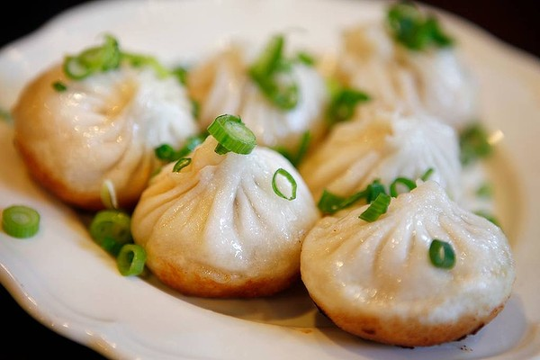 Dumplings on a place with sliced onion