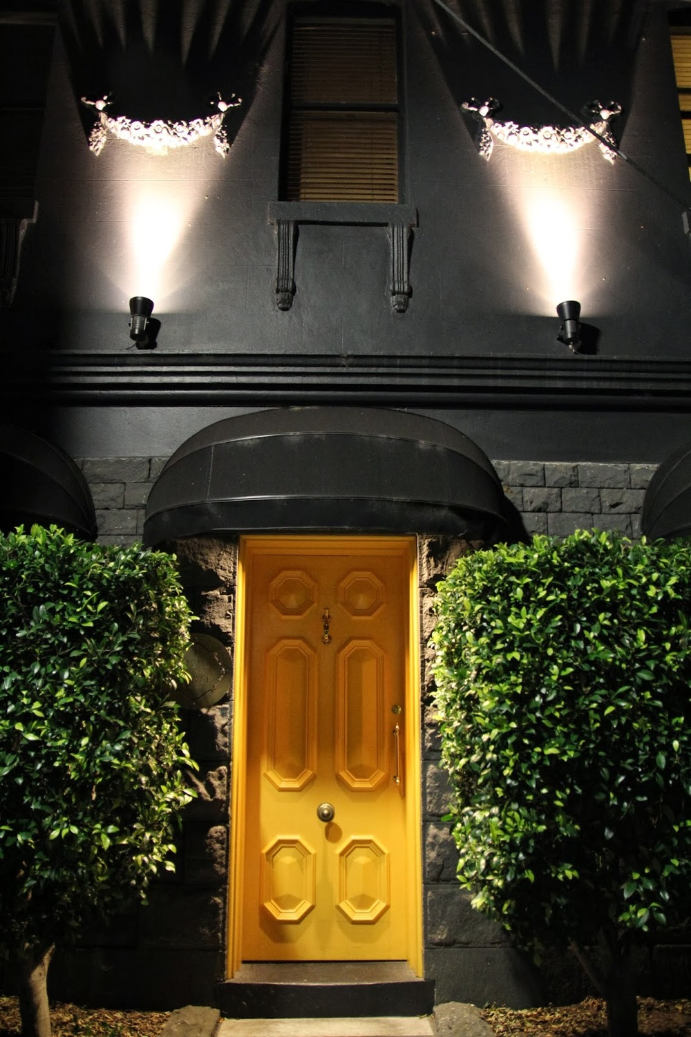 A building at night with a yellow door
