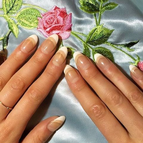 two hands laid out on silky floral blue material