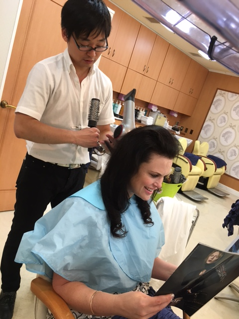 A woman getting hair done at beauty store