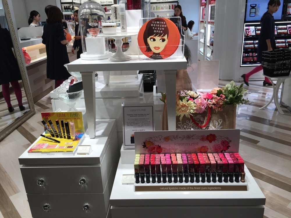 A bunch of beauty products on a stand