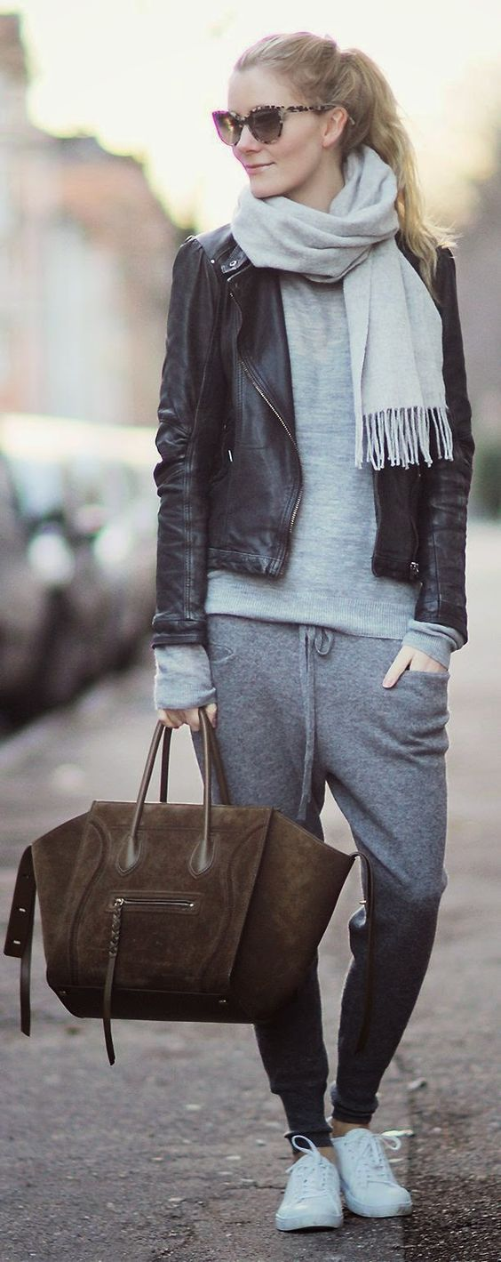 Woman in black leather jacket and big travel bag