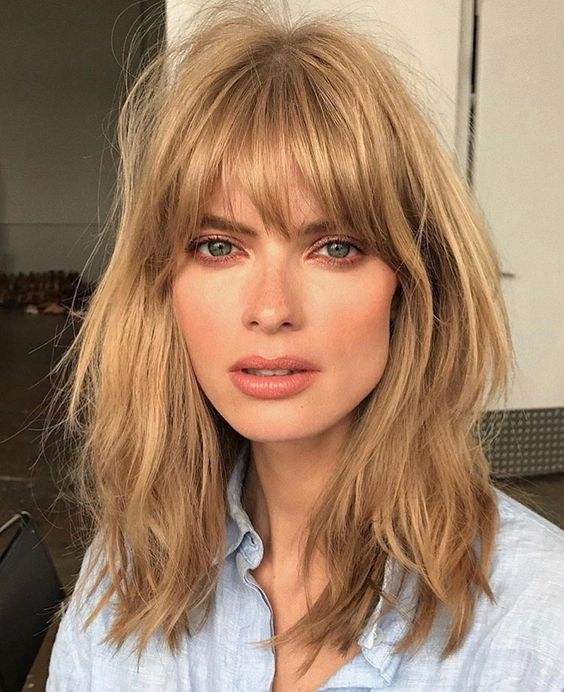 Blonde woman with curtain fringe