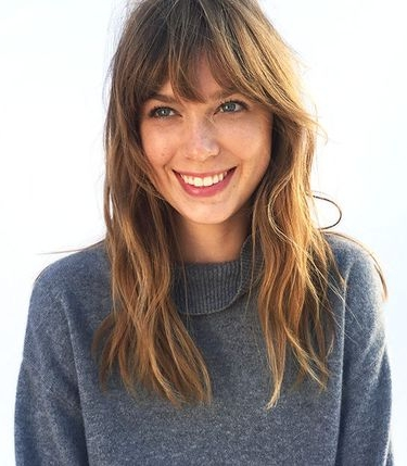 Brunette woman with curtain fringe smiling