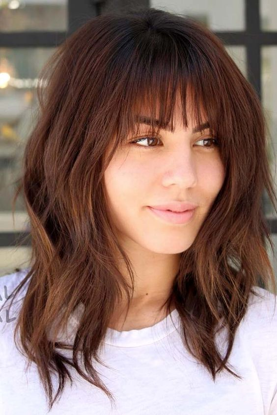 brunette woman with curtain fringe