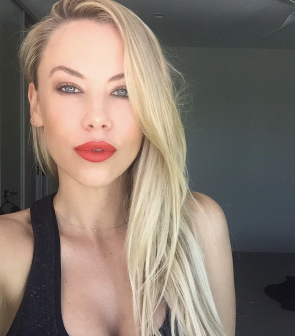 Blonde woman with red lips taking a selfie