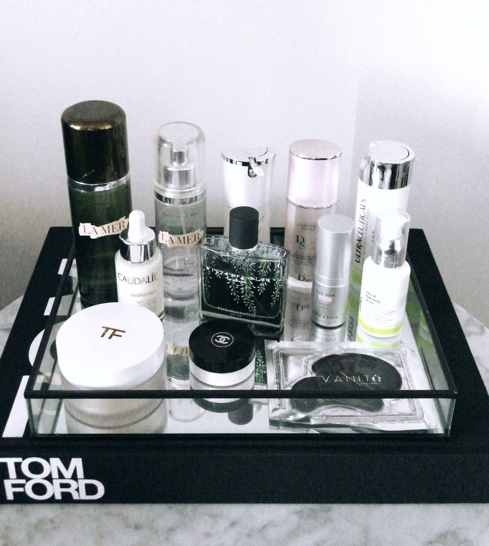 A range of Tom Ford beuty products standing on a black tray