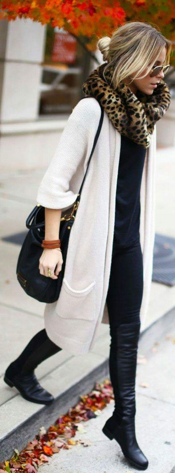 Woman in long white cardigan and black outfit