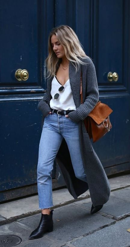 Woman in blue jeans and grey cardigan
