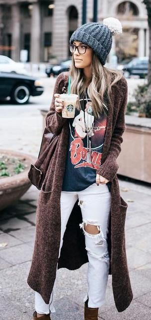Woman in beanie and long brown cardigan