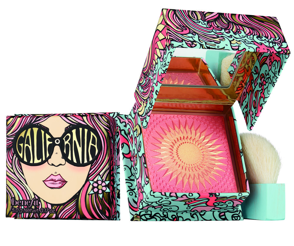 Blush set with face of girl and round sunglasses on the packaging. An image of the sun carved into the blush and a white brush with blue handle sitting upright