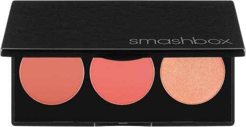 A black, half way opened Smashbox kit with three shades of pink blush lined up next to each other inside