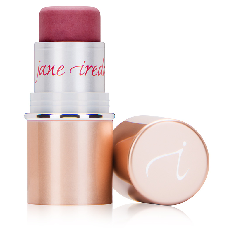 An opened dark pink blush stick with the lid laying next to the stick. Brass and silver coloured casing with 'jane iredale' written across the top of the case
